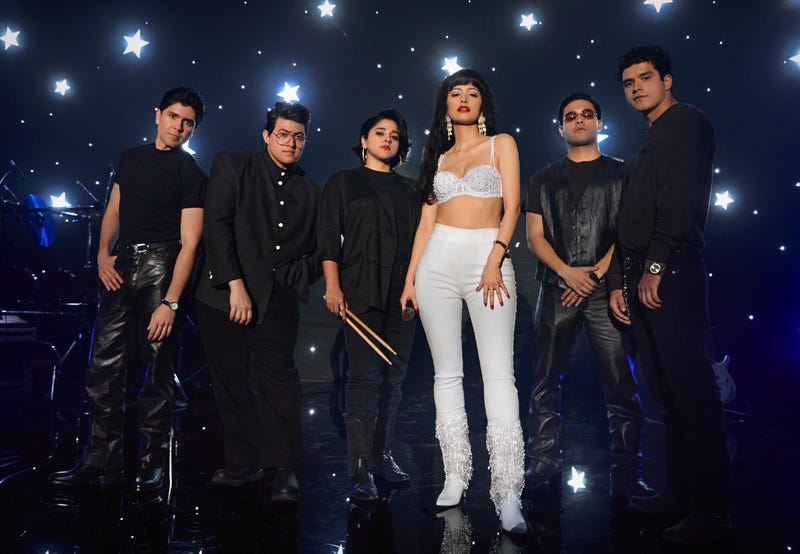 SELENA THE SERIES (L to R) CARLOS ALFREDO JR. as JOE OJEDAand HUNTER REESE PENA as RICKY VELA and NOEMI GONZALEZ as SUZETTE QUINTANILLA and CHRISTIAN SERRATOS as SELENA QUINTANILLA and GABRIEL CHAVARRIA as A.B QUINTANILLA and JESSE POSEY as CHRIS PEREZ in Trailer of SELENA THE SERIES