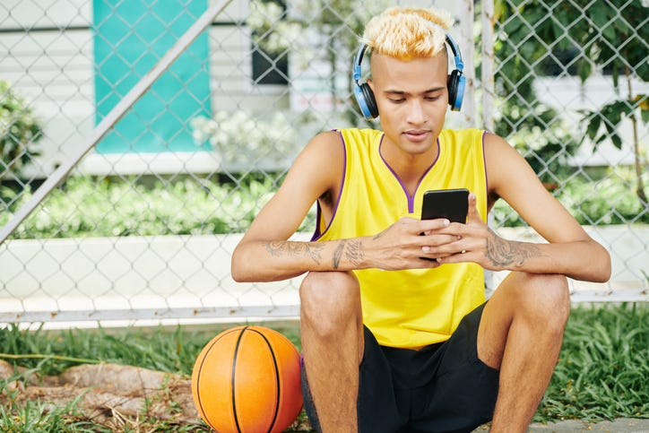 man with basketball and headphones on