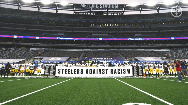 Pittsburgh Steelers stand for National Anthem holding Steelers Against Racism