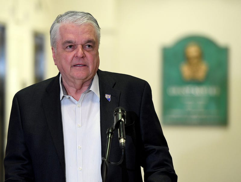 Nevada Governor Steve Sisolak speaks to an assembled group
