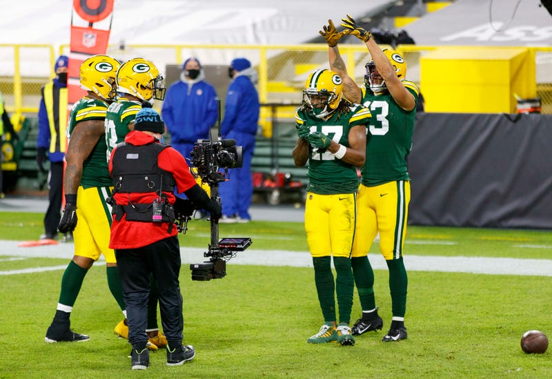 Nov 29, 2020; Green Bay, Wisconsin, USA; Green Bay Packers wide receiver Davante Adams (17) celebrates for the TV camera after catching a touchdown pass during the first quarter against the Chicago Bears at Lambeau Field. Mandatory Credit: Jeff Hanisch-USA TODAY Sports