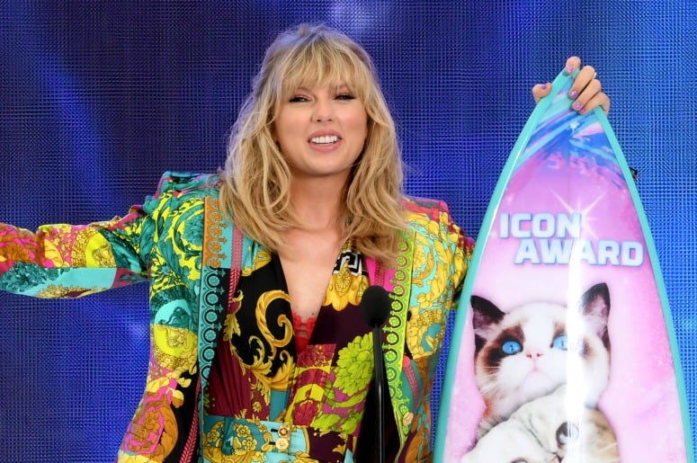 Taylor Swift accepts the Teen Choice Icon Award onstage during Fox's Teen Choice Awards.