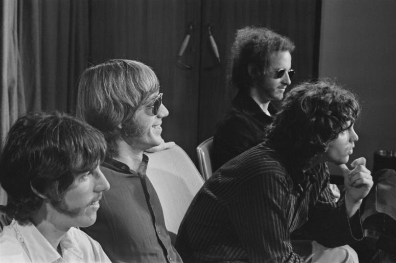 The Doors during a press conference at Heathrow Airport