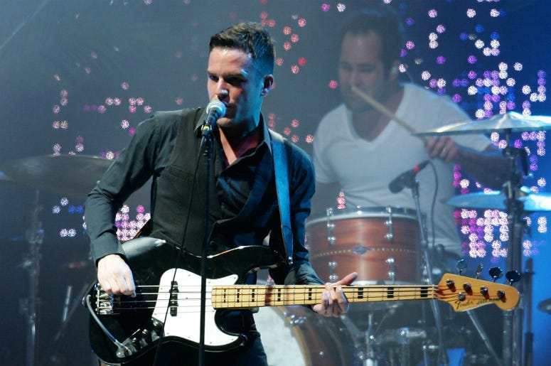 Ronnie Vannucci Jr (R) and Brandon Flowers of The Killers perform on stage at the Melbourne leg of the Good Vibrations music festival.