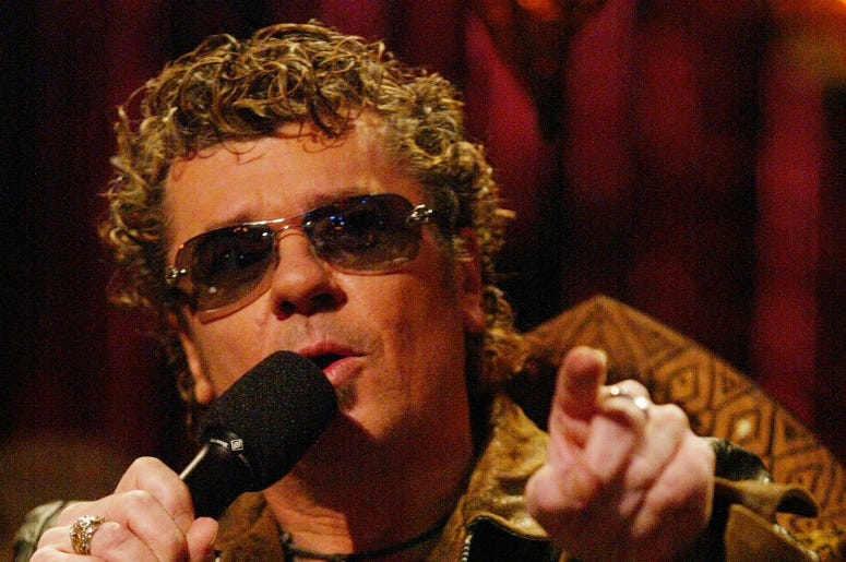 "INXS member Tim Farris speaks during the eighth performance episode of ""Rock Star: INXS"" at CBS Television on August 24, 2005"