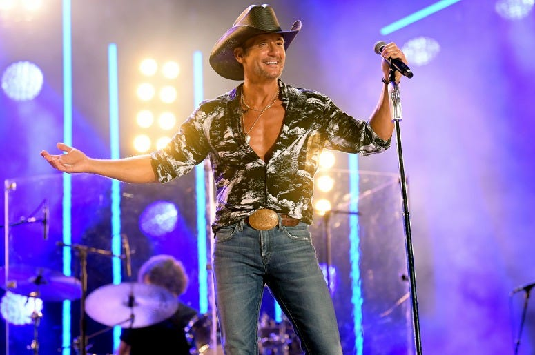 Tim McGraw performs on stage