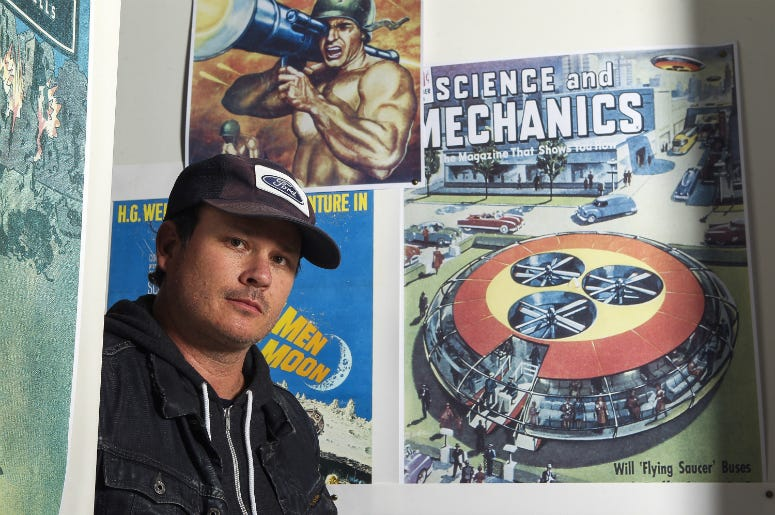 Tom DeLonge poses for a portrait in his shop To the Stars.
