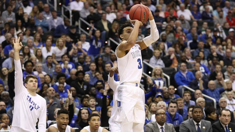 Tre Jones of Duke shoots a 3-pointer in a game during the 2018-19 season.