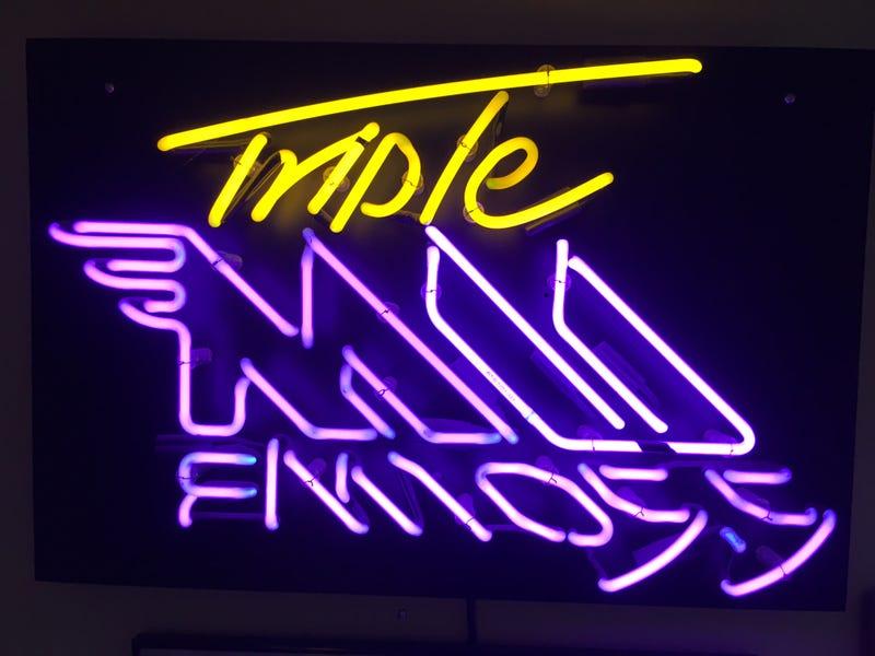 first Triple M logo, in neon light form