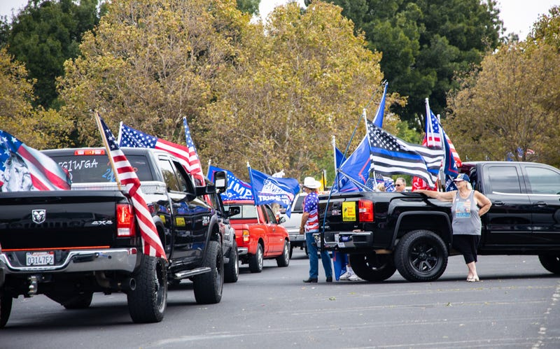 Trump supporters gather in the parking lot of Stoneridge Mall.