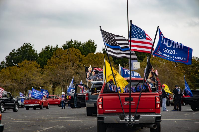 Trucks gather in the parking lot of Stoneridge Mall, decorated with flags showing support for President Trump.