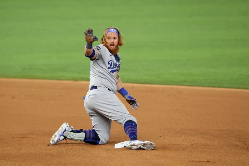 Oct 24, 2020; Arlington, Texas, USA; Los Angeles Dodgers third baseman Justin Turner (10) calls time at second base after hitting a double against the Tampa Bay Rays during the seventh inning of game four of the 2020 World Series at Globe Life Field. Mandatory Credit: Tim Heitman-USA TODAY Sports