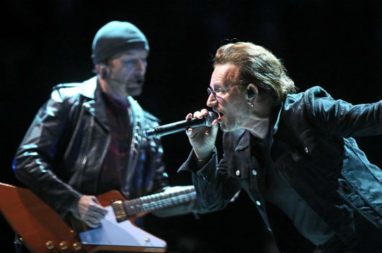 U2's Bono and The Edge perform on at the U2 eXPERIENCE + iNNOCENCE Tour