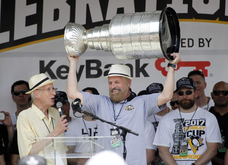 Pittsburgh Penguins broadcasters Mike Lange (left) and Phil Bourque (right) during the Stanley Cup championship parade