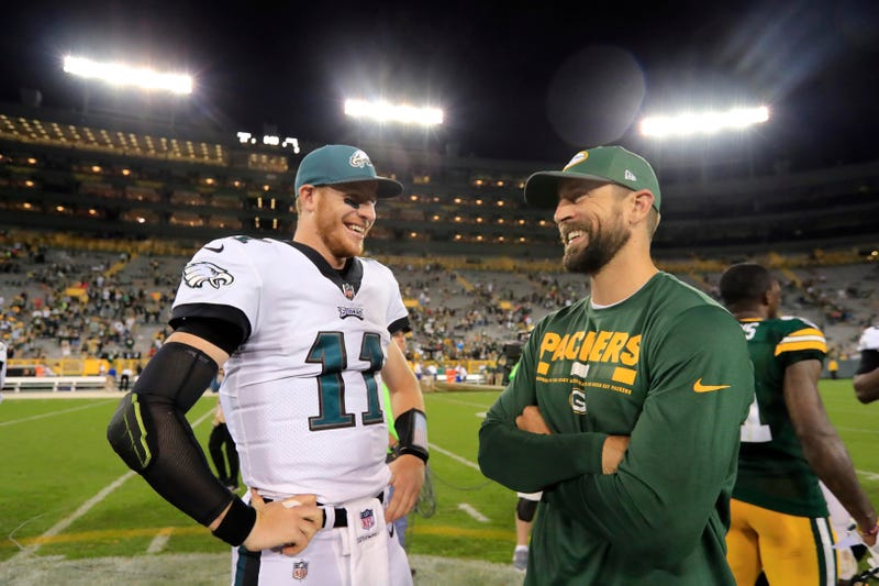 Carson Wentz (left) and the Eagles will face Aaron Rodgers (right) and the Green Bay Packers on Thursday Night Football.