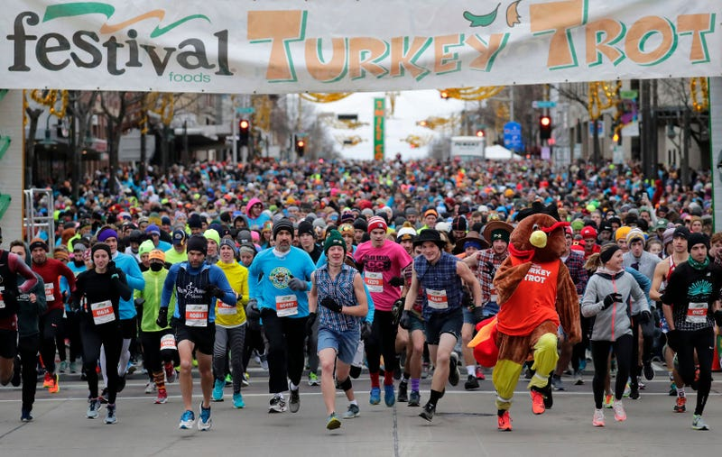 Racers set off from the start line of a turkey trot race