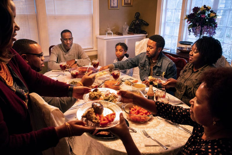 A family celebrates around a Thanksgiving table