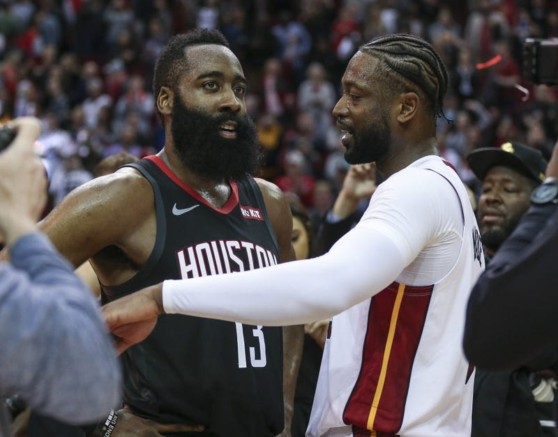 James Harden and Dwyane Wade talk on the court after the game at Toyota Center