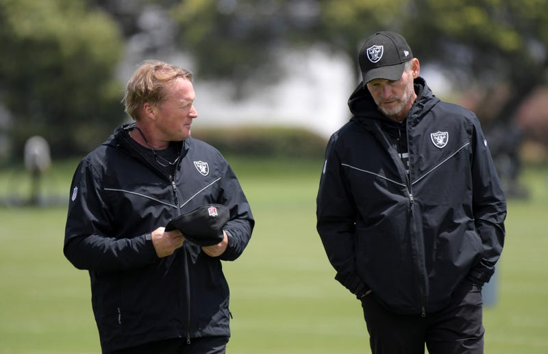 Jon Gruden (left) and Mike Mayock (right) are in a difficult situation with wide receiver Antonio Brown.