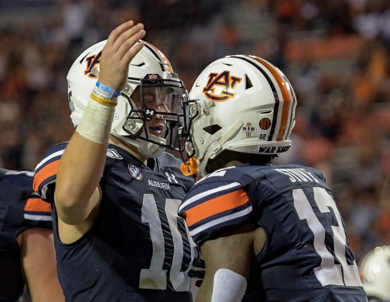 Auburn QB Bo Nix celebrates a touchdown with Eli Stove.