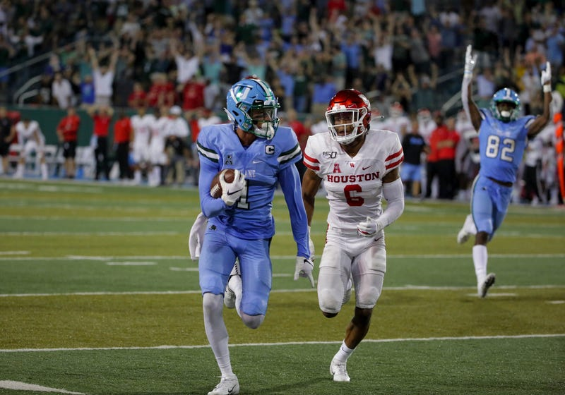 Tulane Green Wave wide receiver Jalen McCleskey (1) runs after a catch for a touchdown past Houston Cougars cornerback Damarion Williams (6) during the fourth quarter at Yulman Stadium. Mandatory Credit: Derick E. Hingle-USA TODAY Sports