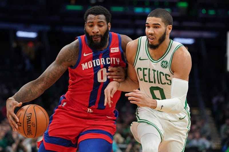 Andre Drummond drives past Jayson Tatum while on the Pistons.