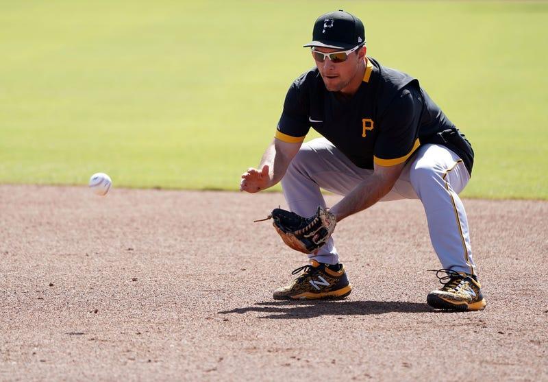 Pirates second baseman fielding a grounder