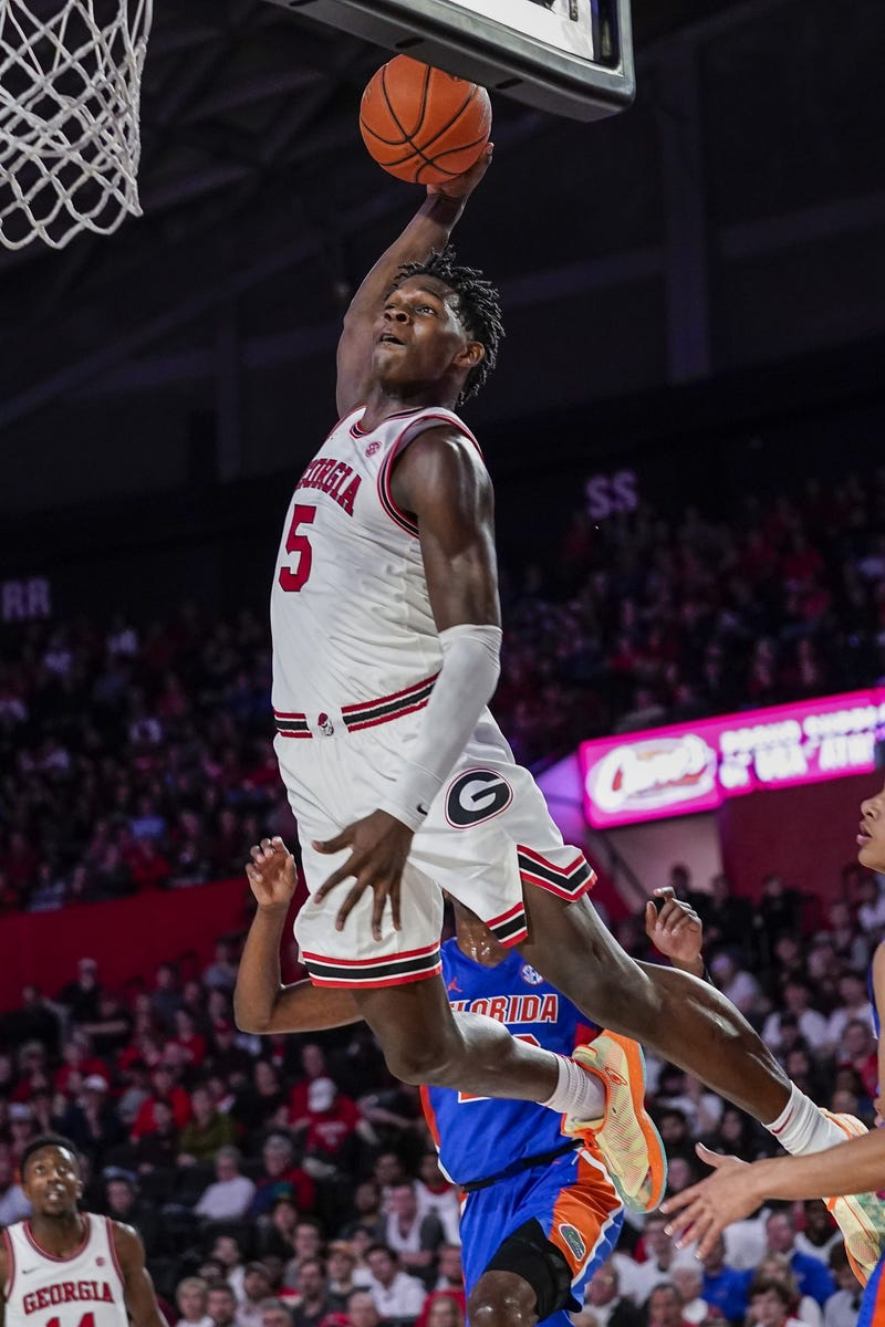 Georgia Bulldogs guard Anthony Edwards (5) dunks the ball against the Florida Gators during the second half at Stegeman Coliseum.