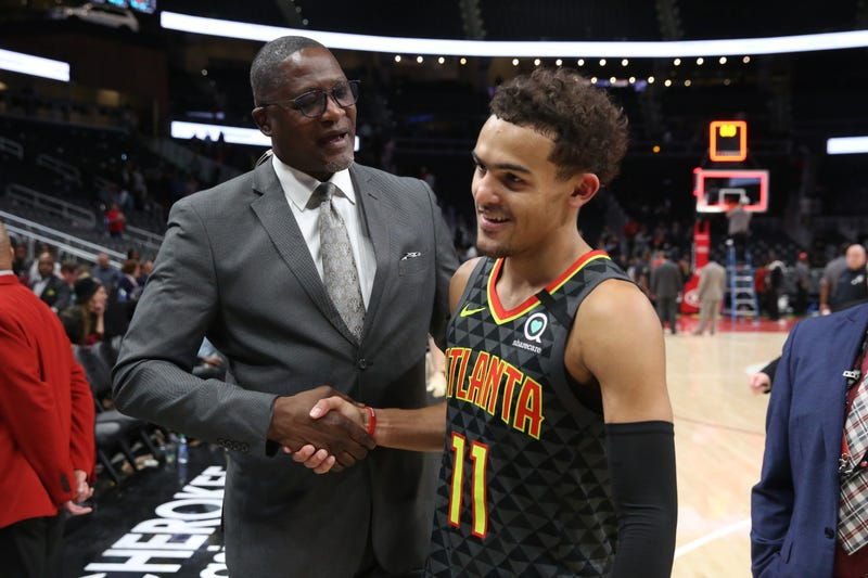 Hawks star Trae Young with former NBA star Dominique Wilkins.