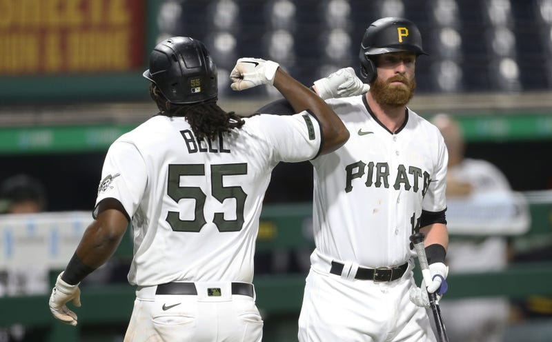 Josh Bell & Colin Moran arm bump