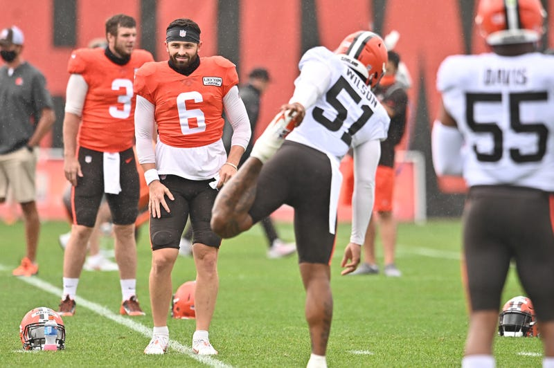 Cleveland Browns quarterback Baker Mayfield (6) stretches along with linebacker Mack Wilson (51) during training camp at the Cleveland Browns training facility
