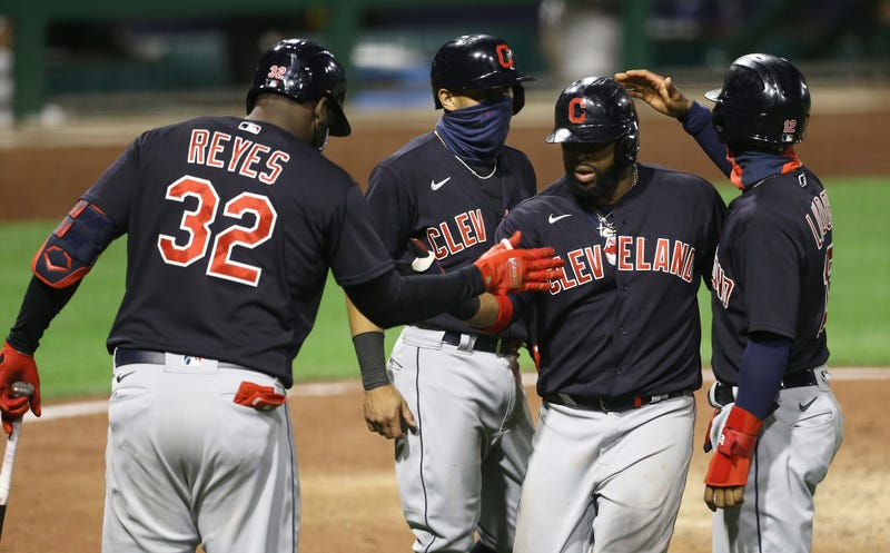 Cleveland Indians designated hitter Franmil Reyes (32) and second baseman Cesar Hernandez (7) and shortstop Francisco Lindor (12) congratulate first baseman Carlos Santana (middle right) on his three run home run against the Pittsburgh Pirates during the tenth inning at PNC Park.