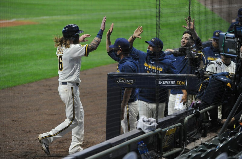 Brewers right fielder Ben Gamel (16) is greeted with high-fives in the Milwaukee Brewers dug out as he scores a run against the Pittsburgh Pirates