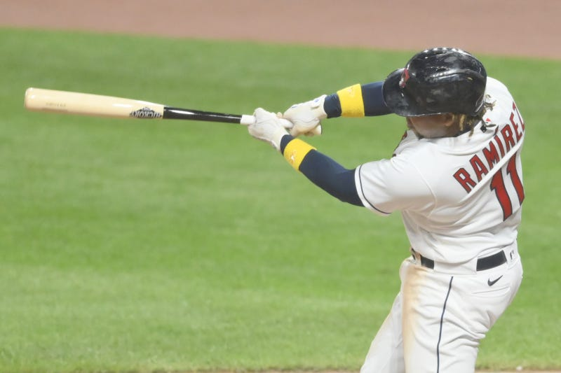 Cleveland Indians third baseman Jose Ramirez (11) hits a two run home run in the fifth inning against the Milwaukee Brewers at Progressive Field.