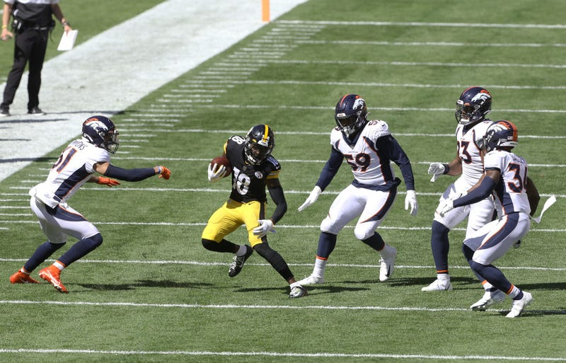 Steelers wide receiver Diontae Johnson (18) runs after a catch as the Denver Broncos defense defends during the second quarter at Heinz Field.