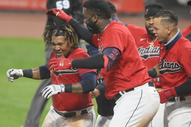 Cleveland Indians third baseman Jose Ramirez (11), left, celebrates his game-winning, three-run home run in the tenth inning against the Chicago White Sox at Progressive Field.