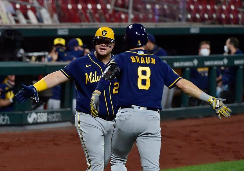 Ryan Braun and Dan Vogelbach celebrate a Braun homer.