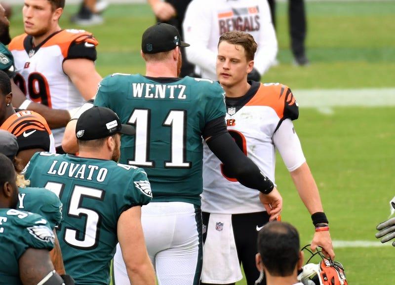 Philadelphia Eagles quarterback Carson Wentz (11) and Cincinnati Bengals quarterback Joe Burrow (9) meet on the field after the game at Lincoln Financial Field.