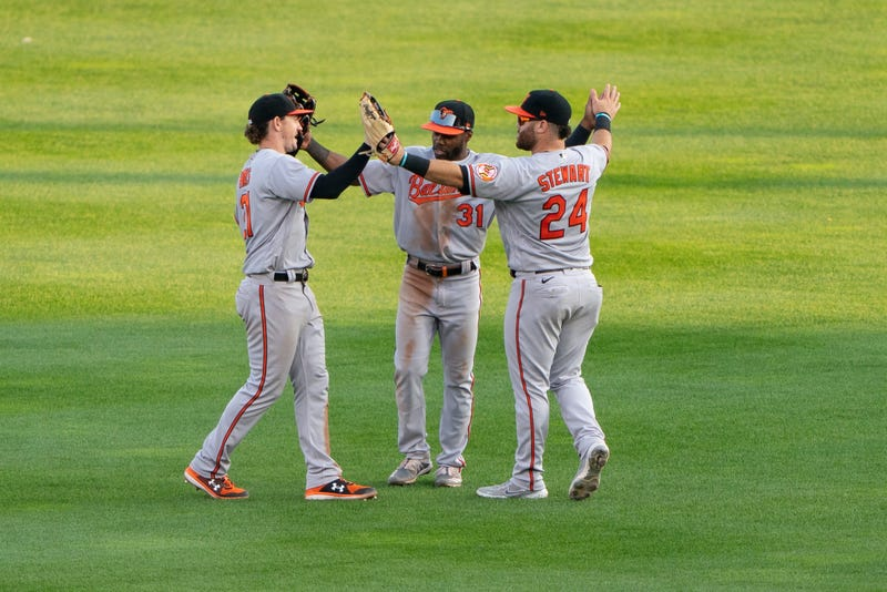O's outfielders DJ Stewart, Cedric Mullins, and Austin Hays in the outfield.