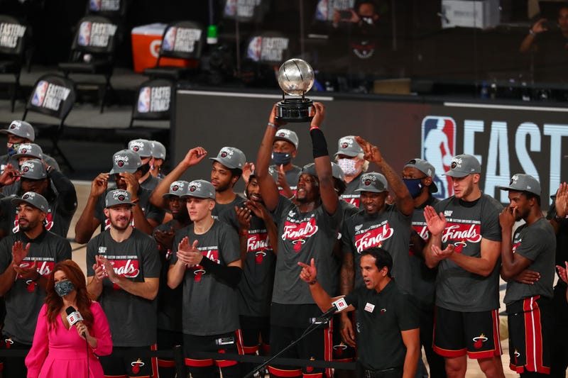 Miami Heat hoist the Eastern Conference Finals Trophy