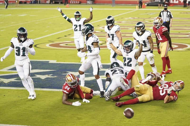 Philadelphia Eagles players celebrate after an incomplete pass by the San Francisco 49ers during the fourth quarter at Levi's Stadium.