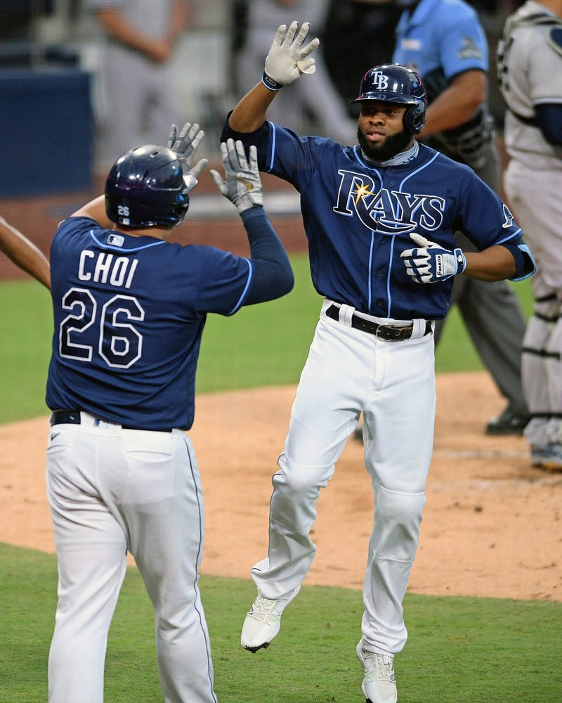 Tampa Bay Rays right fielder Manuel Margot (13) celebrates with first baseman Ji-Man Choi (26) after hitting a two-run homerun in the 3rd inning against the New York Yankees during game two of the 2020 ALDS at Petco Park.