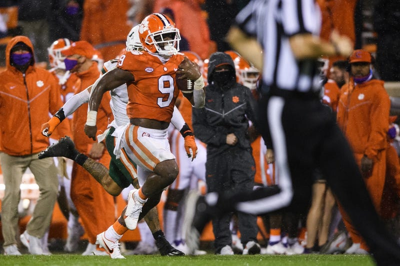 Clemson Tigers running back Travis Etienne (9) runs for a 72-yard touchdown against the Miami Hurricanes during the third quarter at Memorial Stadium.