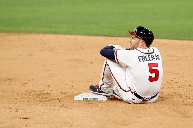 Atlanta Braves first baseman Freddie Freeman (5) rests on first base after sliding in safely for a double during the eighth inning against the Los Angeles Dodgers in game five of the 2020 NLCS