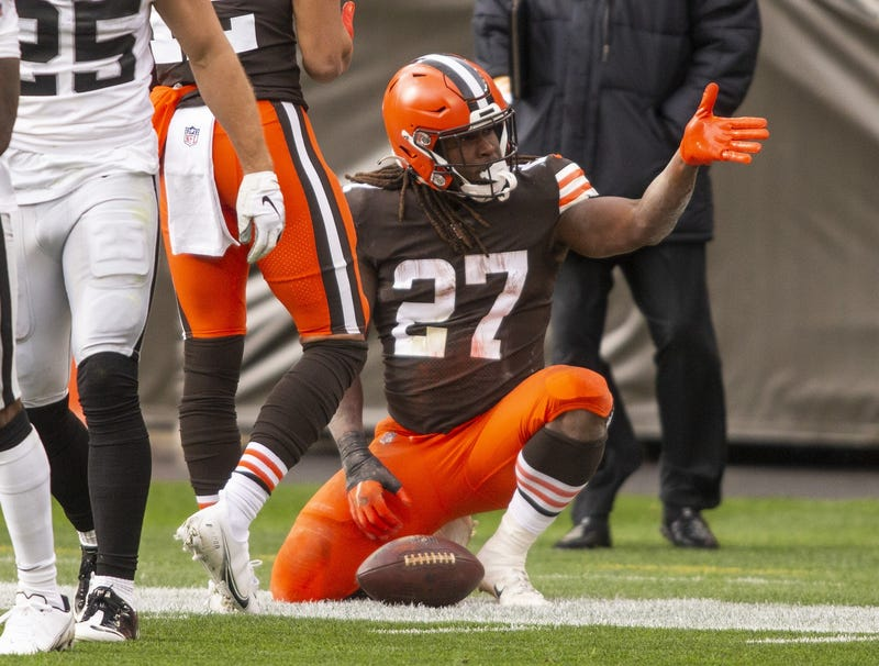 Cleveland Browns running back Kareem Hunt (27) signals for a first down following his run against the Las Vegas Raiders during the second quarter at FirstEnergy Stadium.