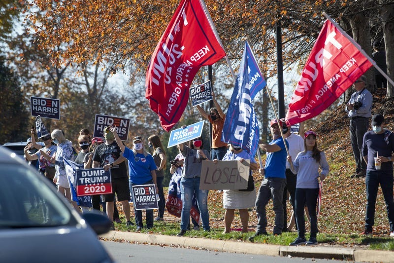 Crowds gather outside the Trump National Golf Club in Sterling, Virginia, when President Donald Trump was seen golfing on Nov. 7, 2020. Photo credit Jack Gruber-USA TODAY