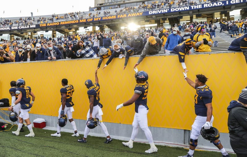 Mountaineers shake hands at home