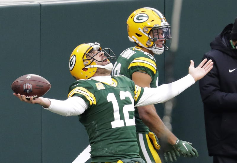 Packers' QB Aaron Rodgers celebrates after a rushing TD.