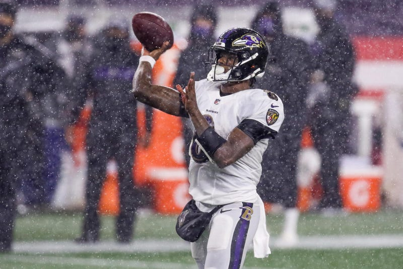 Ravens QB Lamar Jackson throws a pass in the rain during this season's loss to the Patriots