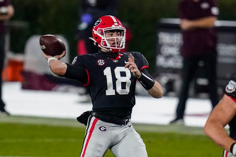 Georgia Bulldogs quarterback JT Daniels (18) throws a touchdown pass against the Mississippi State Bulldogs during the first half at Sanford Stadium.